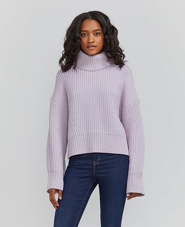 Organic merino fisherman's rib roll neck sweater